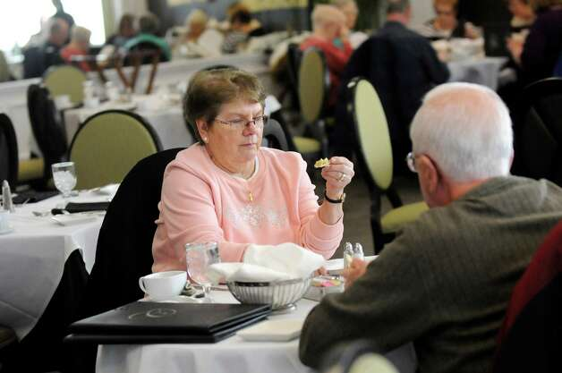 Barbara Opalka of Rotterdam, center, has lunch with her husband Joseph Opalka, right, at the Casola Dining Room on Wednesday, Feb. 18, 2015, at Schenectady County Community College in Schenectady, N.Y. (Cindy Schultz / Times Union) Photo: Cindy Schultz / 00030647A