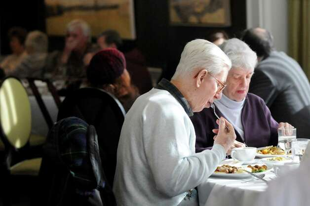 Herbert Sosedow of East Greenbush, center, has lunch with his wife Ella Sosedow, right, at the Casola Dining Room on Wednesday, Feb. 18, 2015, at Schenectady County Community College in Schenectady, N.Y. (Cindy Schultz / Times Union) Photo: Cindy Schultz / 00030647A