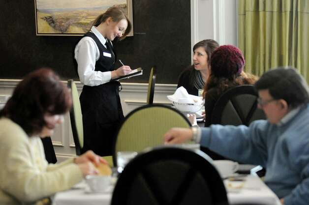 Culinary student Cassandra Stefaniak, center, takes a lunch order at the Casola Dining Room on Wednesday, Feb. 18, 2015, at Schenectady County Community College in Schenectady, N.Y. (Cindy Schultz / Times Union) Photo: Cindy Schultz / 00030647A