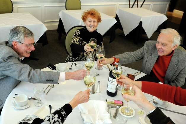 Friends have a toast before lunch at the Casola Dining Room on Wednesday, Feb. 18, 2015, at Schenectady County Community College in Schenectady, N.Y. From left are Sean McCullough, June Dieffenbach and her husband Bruce Dieffenbach. (Cindy Schultz / Times Union) Photo: Cindy  Schultz / 00030647A