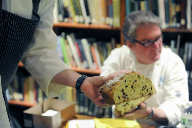 Chef Michael Kiernan of Wheatfields holds up an entry during judging of the second annual Maureen Farrell McCarthy Irish Soda Bread Competition at the Irish American Heritage Museum on Saturday March 8, 2014 in Albany, N.Y. (Michael P. Farrell/Times Union) ORG XMIT: MER2014030816502984 Photo: Michael P. Farrell / 00025694A