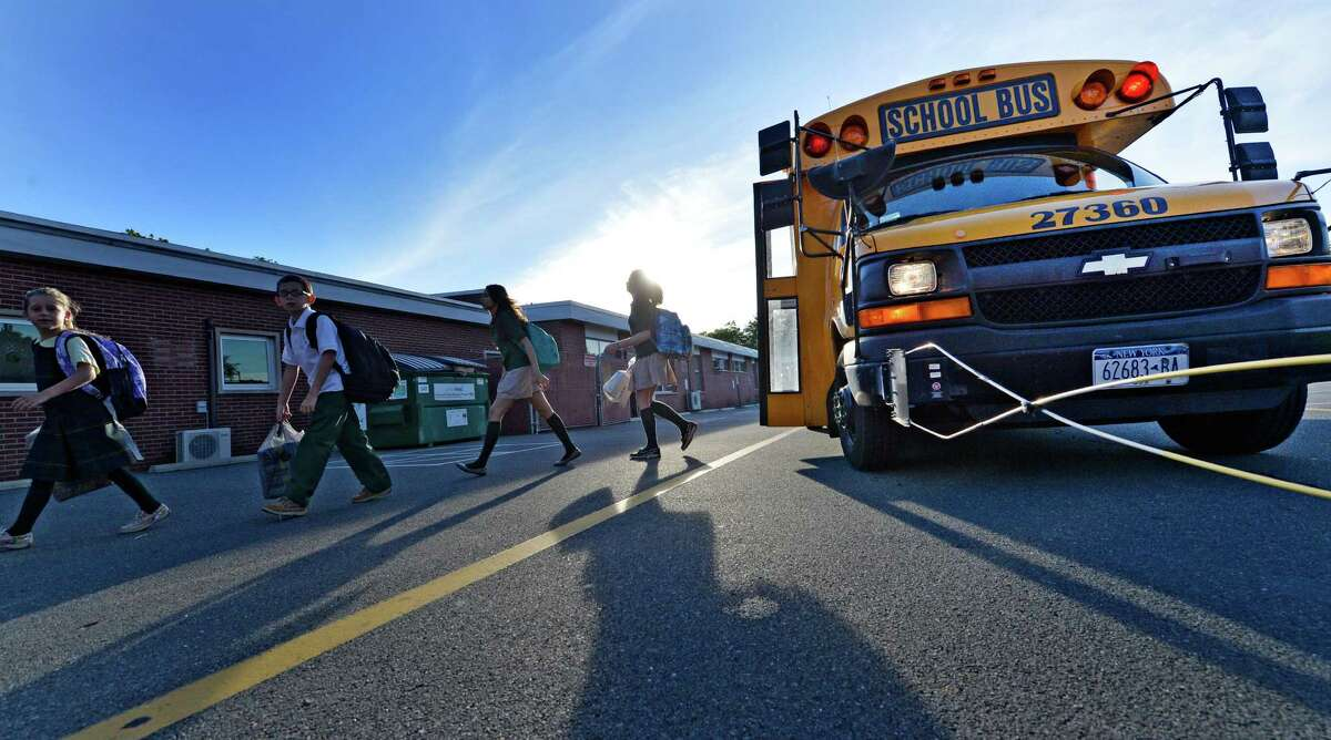 Students leave the school bus at Mater Christi School on opening day Wednesday Sept. 3, 2014 in Albany, N.Y. (Skip Dickstein/Times Union)