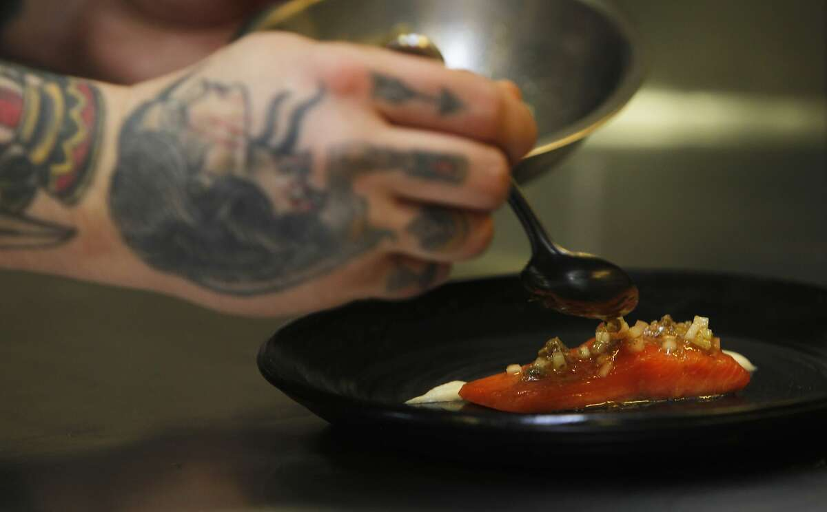 San Francisco chef Brett Cooper puts the finishing touches on a dish at Coi Restaurant in San Francisco, Calif. Monday, February 9, 2015 while a crew from ChefsFeed, an app showcasing chef's favorite restaurants, film a short stop-action movie of his process.