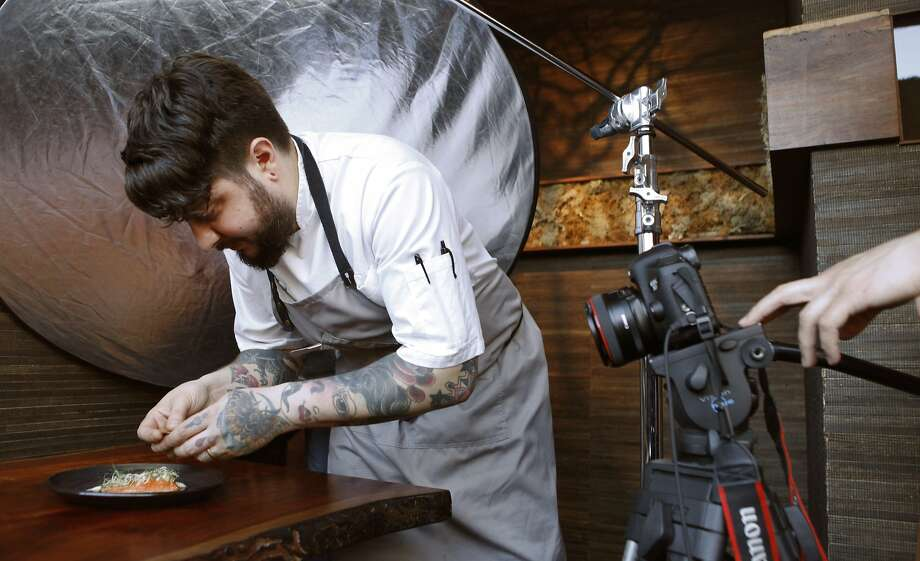 San Francisco chef Brett Cooper puts the finishing touches on a dish at Coi Restaurant in San Francisco, Calif. Monday, February 9, 2015 while a crew from ChefsFeed, an app showcasing chef's favorite restaurants, film a short stop-action movie of his process. Photo: Jessica Christian, The Chronicle