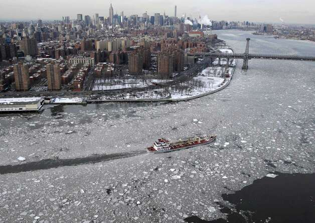 A boat makes its way through ice on the East River in New York, Tuesday, Feb. 24, 2015. A wide swath of the country is experiencing record-breaking temperatures while other areas are expecting more winter precipitation Tuesday. (AP Photo/Seth Wenig) ORG XMIT: NYSW102 Photo: Seth Wenig, AP / AP