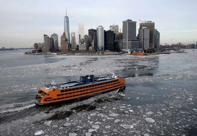 A ferry makes its way through ice in New York, Tuesday, Feb. 24, 2015. The Weather Service said temperatures would be 15 to 25 degrees below average for most of the East Coast west to the Great Lakes and lower Mississippi River Valley. (AP Photo/Seth Wenig) ORG XMIT: NYSW101 Photo: Seth Wenig, AP / AP