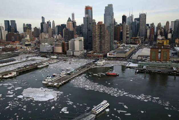 Boats make their way through ice in the Hudson River in New York, Tuesday, Feb. 24, 2015. The Weather Service said temperatures would be 15 to 25 degrees below average for most of the East Coast west to the Great Lakes and lower Mississippi River Valley. (AP Photo/Seth Wenig) ORG XMIT: NYSW109 Photo: Seth Wenig, AP / AP