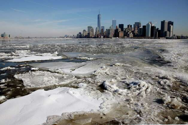 Ice flows in New York harbor near lower Manhattan, Tuesday, Feb. 24, 2015. A wide swath of the country is experiencing record-breaking temperatures while other areas are expecting more winter precipitation Tuesday. (AP Photo/Richard Drew) ORG XMIT: NYRD108 Photo: Richard Drew, AP / AP