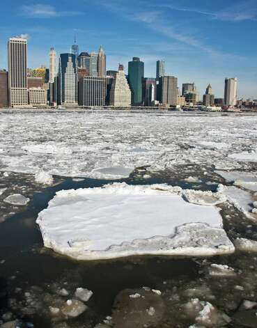 Manhattan's skyline forms the horizon as ice breaks apart flowing along Brooklyn's East River waterfront, Tuesday, Feb. 24, 2015, in New York.  Forecast calls for highs around 20 degrees, with lows down into the teens. Temperatures will be below freezing today and could reach below zero with the windchill, according to the National Weather Service. (AP Photo/Bebeto Matthews) ORG XMIT: NYBM105 Photo: Bebeto Matthews, AP / AP