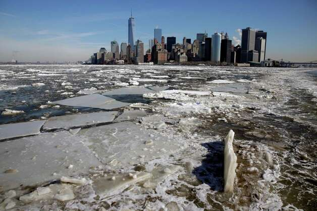 Ice flows in New York harbor near lower Manhattan, Tuesday, Feb. 24, 2015. A wide swath of the country is experiencing record-breaking temperatures while other areas are expecting more winter precipitation Tuesday. (AP Photo/Richard Drew) ORG XMIT: NYRD102 Photo: Richard Drew, AP / AP