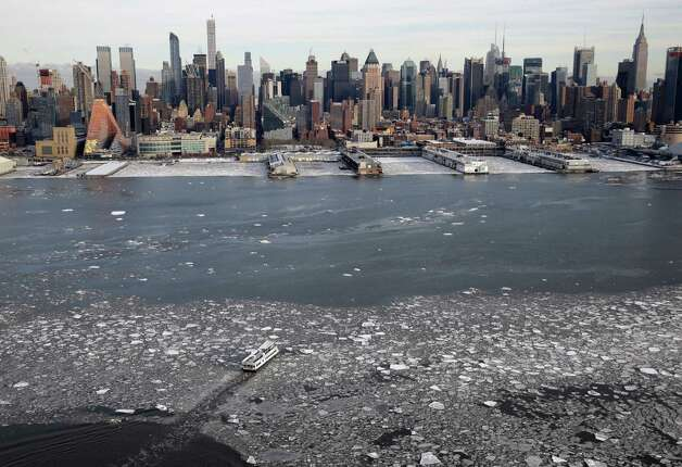 A boat travels across the Hudson River towards Manhattan, Tuesday, Feb. 24, 2015, in New York. A wide swath of the country is experiencing record-breaking temperatures while other areas are expecting more winter precipitation Tuesday. (AP Photo/Seth Wenig) ORG XMIT: NYSW105 Photo: Seth Wenig, AP / AP
