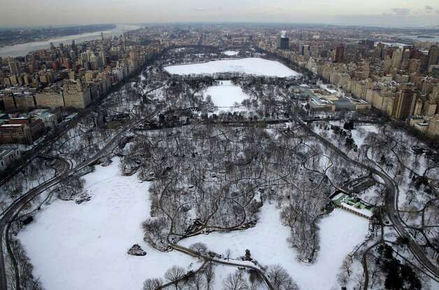 Snow covers Central Park in New York, Tuesday, Feb. 24, 2015. A wide swath of the country is experiencing record-breaking temperatures while other areas are expecting more winter precipitation Tuesday. (AP Photo/Seth Wenig) ORG XMIT: NYSW111 Photo: Seth Wenig, AP / AP
