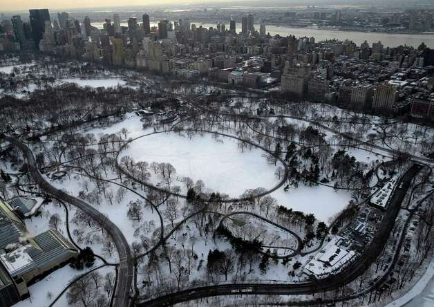 Snow covers Central Park in New York, Tuesday, Feb. 24, 2015. A wide swath of the country is experiencing record-breaking temperatures while other areas are expecting more winter precipitation Tuesday. (AP Photo/Seth Wenig) ORG XMIT: NYSW110 Photo: Seth Wenig, AP / AP