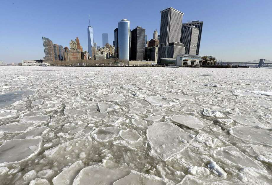 TOPSHOTS A view of Lower Manhattan  from  the Staten Island Ferry February 25, 2015 as the New York Harbor is filled with large chunks of ice.  Heavy ice in the East River shut down commuter ferry service on Tuesday morning stopping travel between Manhattan, Queens, and Brooklyn. AFP PHOTO /  TIMOTHY  A. CLARYTIMOTHY A. CLARY/AFP/Getty Images Photo: TIMOTHY A. CLARY, Getty / AFP