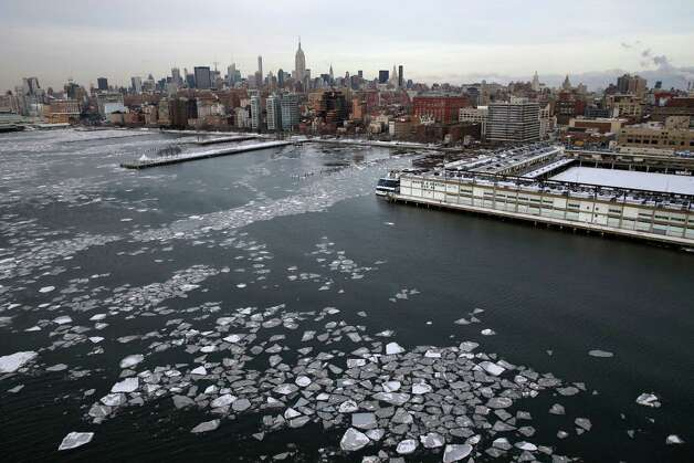 Ice floats in the Hudson River near Manhattan, Tuesday, Feb. 24, 2015, in New York. A wide swath of the country is experiencing record-breaking temperatures while other areas are expecting more winter precipitation Tuesday. (AP Photo/Seth Wenig) ORG XMIT: NYSW108 Photo: Seth Wenig, AP / AP