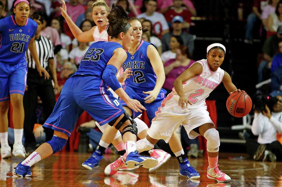 North Carolina State's Len'Nique Brown-Hoskin (right), a former Wagner star, tries to avoid Duke's Mercedes Riggs (12) and Rebecca Greenwell (23) during the first half on Sunday  in Raleigh, N.C. Photo: Karl B DeBlaker /Associated Press / FR7226 AP