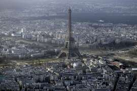 (FILES) -- An aerial file photo taken on January 11, 2015 shows the Eiffel Tower in Paris. At least five drones were spotted flying over central Paris landmarks during the night and police were unable to catch the operators,  sources close to the probe said on February 24, 2015. The country has been hit by a series of mysterious drone overflights at nuclear plants and more recently over the presidential palace, and the fresh sightings come at a time of heightened security following last month's jihadist attacks that left 17 people dead.   AFP PHOTO / KENZO TRIBOUILLARDKENZO TRIBOUILLARD/AFP/Getty Images