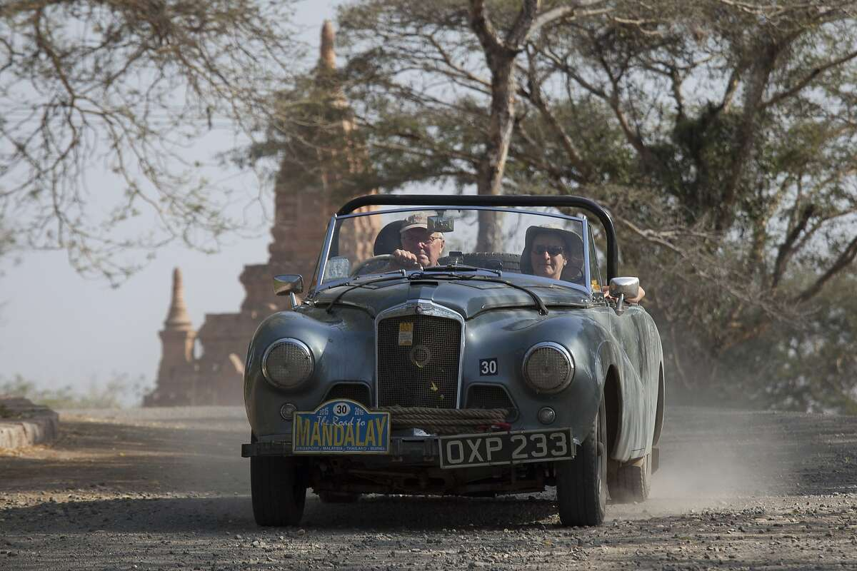 MANDALAY HERE WE COME: David and Jo Roberts near the finish line in their 1926 Bentley Tourer on the final day of the Road to Mandalay 24-day car rally through southeast Asia in Bagan, Myanmar. More than 70 crews embarked on the Endurance Rally Association's tour through Singapore, Malaysia, Thailand and Myanmar, finishing in the historic city of Bagan.
