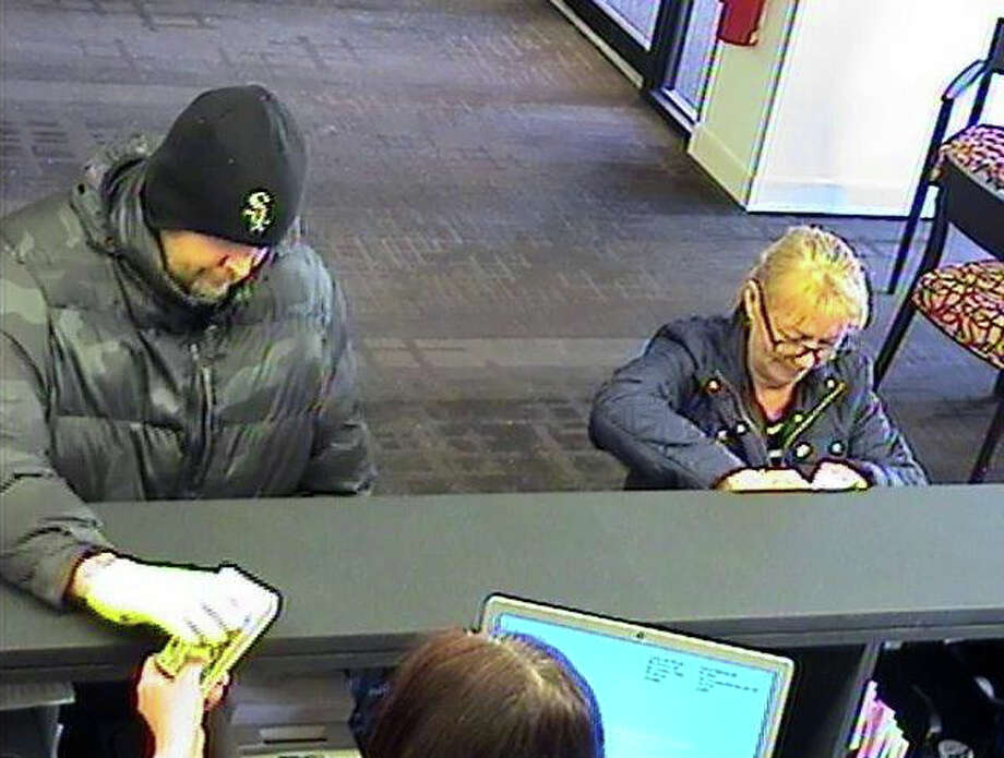 Police in New Milford, Conn., said this man (left) robbed a Bank of America branch on Main Street Wednesday afternoon, Feb. 24, 2015. Photo: Contributed Photo, Nelson Oliveira / The News-Times