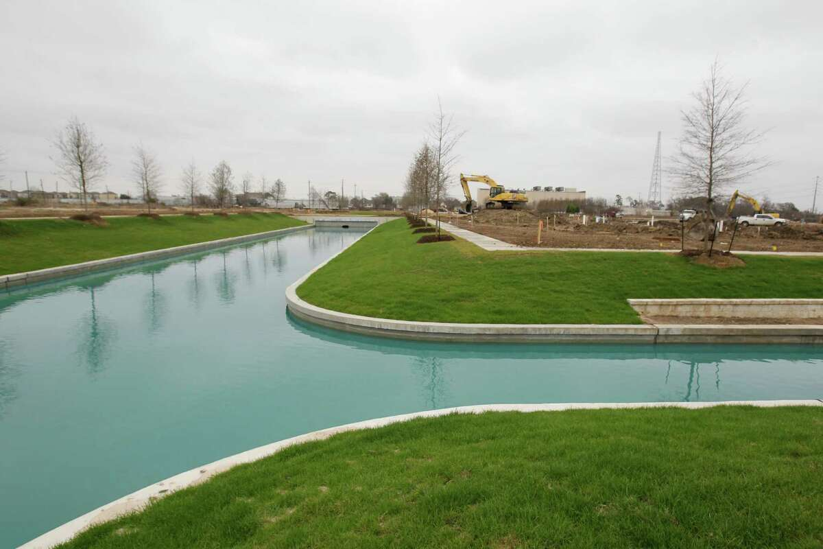 Somerset Green, under construction inside the 610 Loop, will have a canal running through part of the former industrial property.