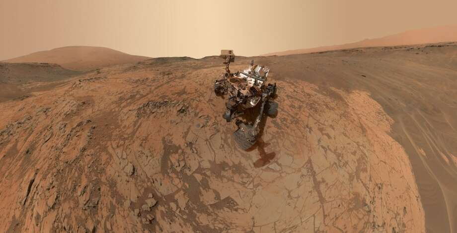 "NASA capiton: This self-portrait of NASA's Curiosity Mars rover shows the vehicle at the ""Mojave"" site, where its drill collected the mission's second taste of Mount Sharp. The scene combines dozens of images taken during January 2015 by the Mars Hand Lens Imager (MAHLI) camera at the end of the rover's robotic arm."