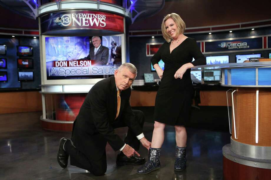 Don Nelson admires the sparkling shoes of Meteorologist Casey Curry while getting ready for the midmorning show during his final week at KTRK. Photo: Mayra Beltran, Staff / © 2015 Houston Chronicle