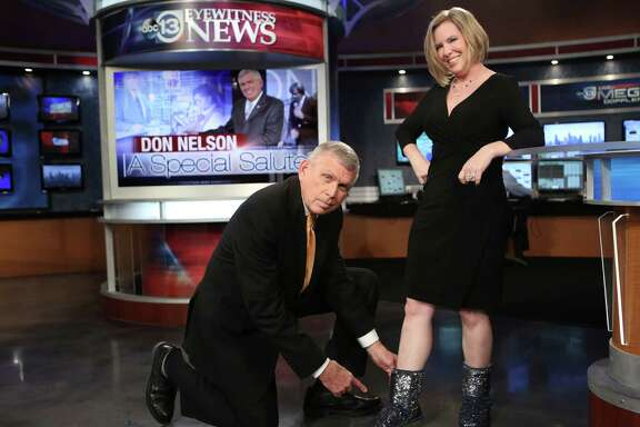 Don Nelson admires the sparkling shoes of Meteorologist Casey Curry while getting ready for the midmorning show during his final week at KTRK.