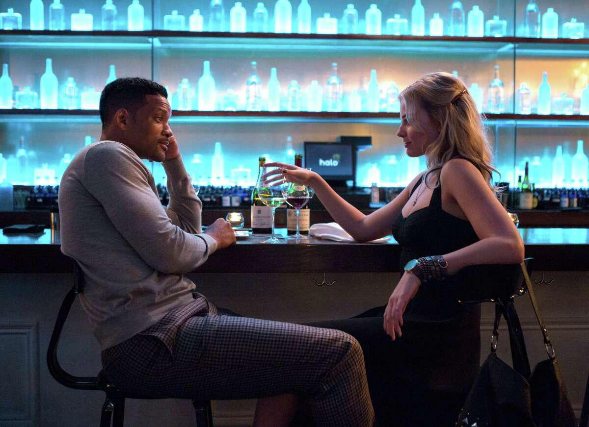 Will Smith plays Nicky and Margot Robbie is Jess in