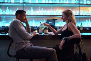 "Will Smith plays Nicky and Margot Robbie is Jess in ""Focus."""