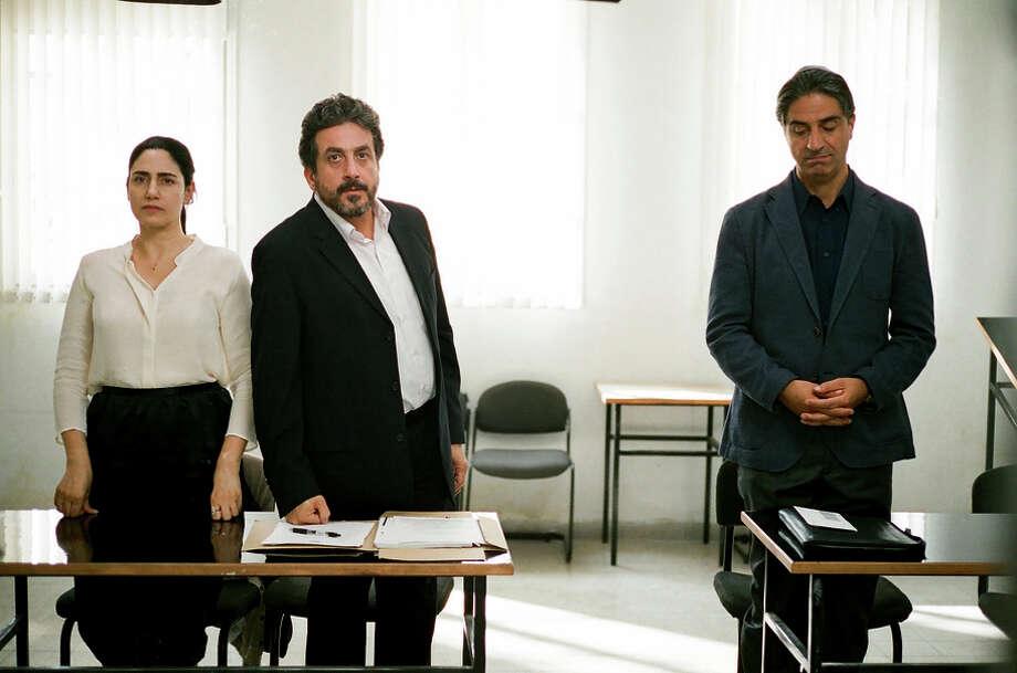 "Ronit Elkabetz (left), Menashe Noy and Simon Abkarian in ""Gett: The Trial of Viviane Amsalem."" Photo: HANDOUT / Washington Post / THE WASHINGTON POST"
