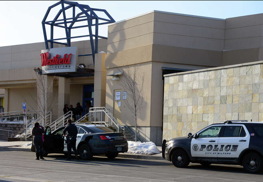 Two Milford police vehicles stop at an entrance to the Westfield Connecticut Post Mall in Milford, Conn. on Wednesday Feb. 25, 2015. Malls around the country and in our region have heightened security procedures and presence after recent calls for violence by the terrorist group Al-Shabaab in Somalia. Photo: Christian Abraham / Connecticut Post