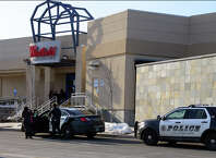 Two Milford police vehicles stop at an entrance to the Westfield Connecticut Post Mall in Milford, Conn. on Wednesday Feb. 25, 2015. Malls around the country and in our region have heightened security procedures and presence after recent calls for violence by the terrorist group Al-Shabaab in Somalia.