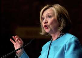 In this file photo, former Secretary of State Hillary Rodham Clinton speaks at Georgetown University in Washington. The Clintons' foundation poses political risks for Clinton as she embarks on a second presidential campaign. She has grappled with bad headlines over the foundation's receipt of large donations from foreign governments.