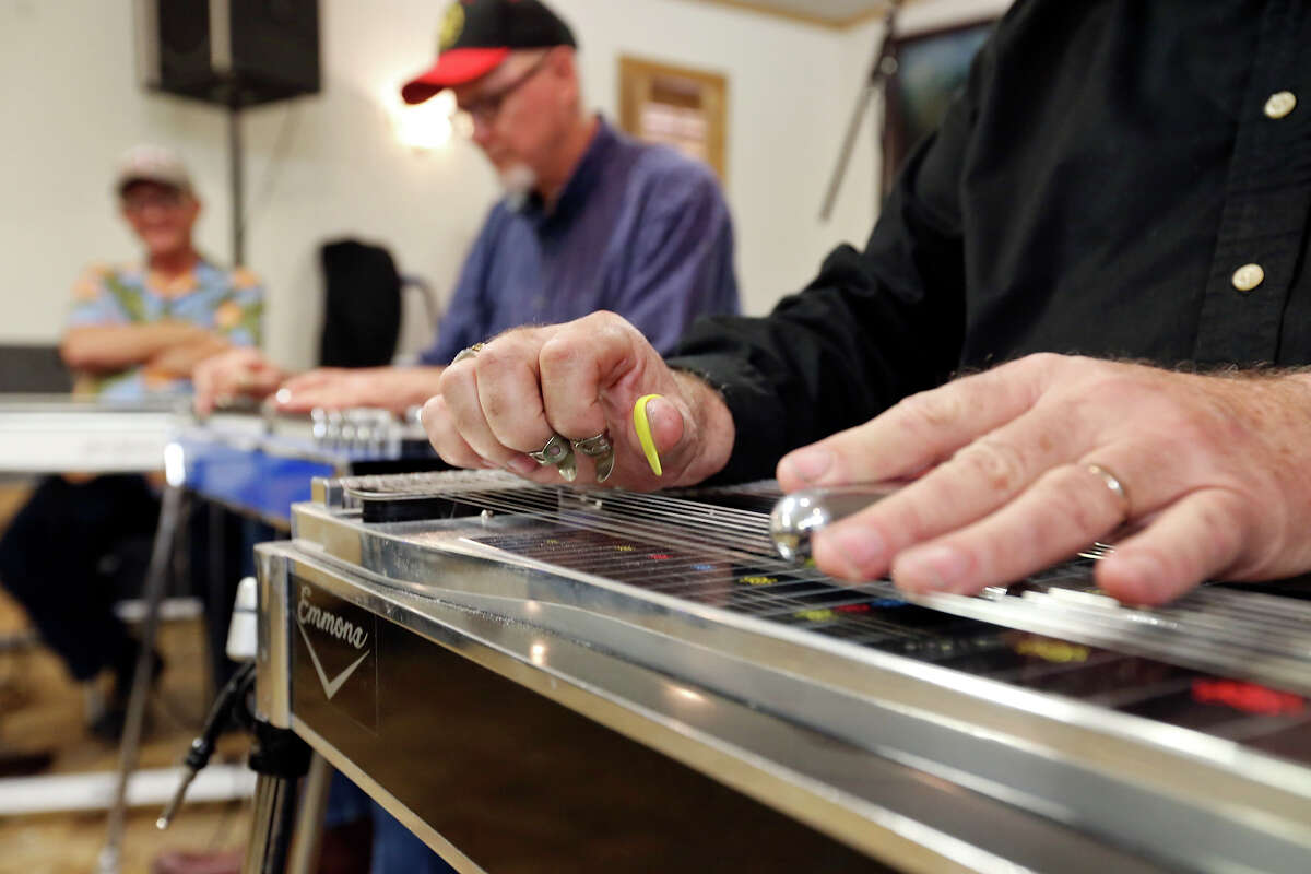 Roger Edginton (right) has played pedal steel for almost 60 years.