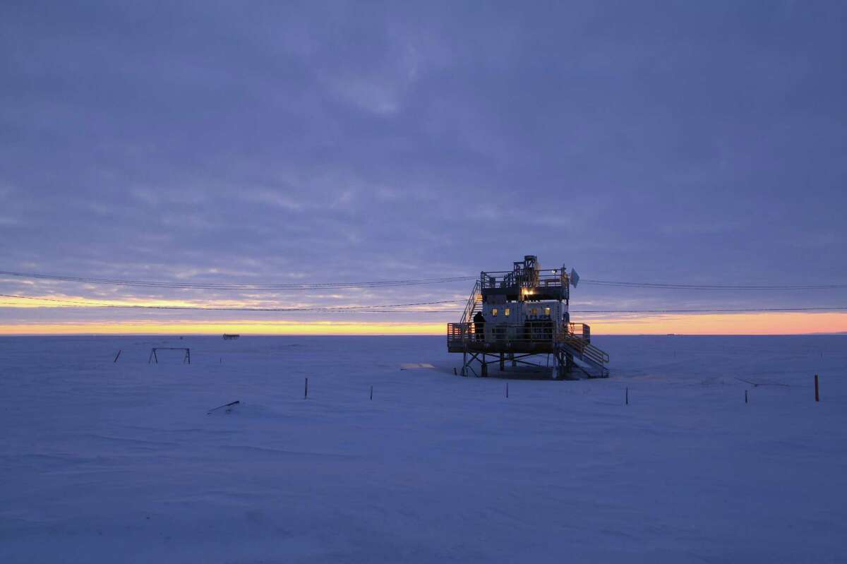 Scientists witness and measure carbon dioxide trapping heat in the sky above in 2011, confirming human-caused global warming, using the Atmospheric Emitted Radiance Interferometer seen here, located in Barrow, Alaska.