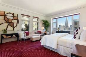 The master suite includes a sitting area and dramatic views.