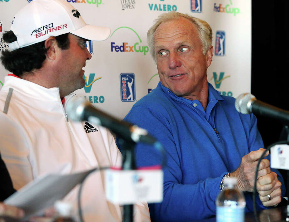 Greg Norman makes a golf gesture with Valero Texas Open 2014 champion Steven Bowditch as they make a promotional appearance  at the TPC San Antonio on February 25, 2015. Photo: Tom Reel / San Antonio Express-News
