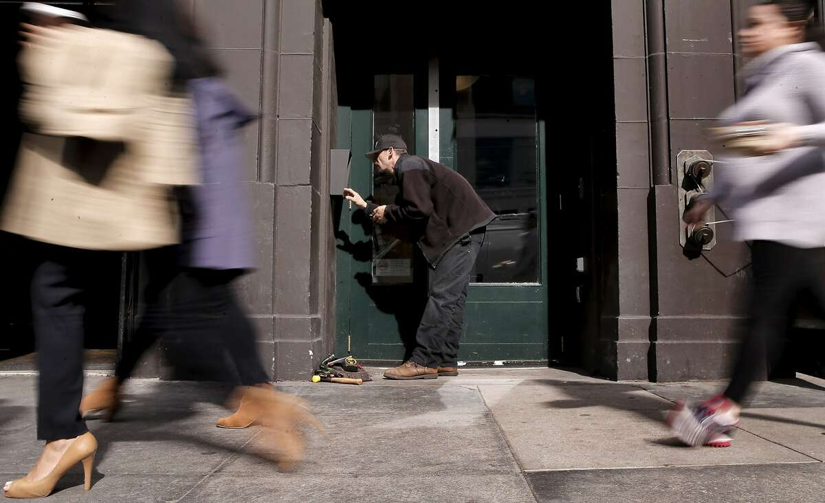 Jon Ahlf, a Warman Security technician, on Wed. February 25, 2015, in San Francisco, Calif., in the process of updating an intercom system to handle the new dialing system that requires old 415 users to dial the area code when making local calls.