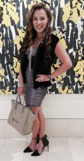 LeAnn Cyr calls her look casual chic: a black mink vest over a gray bandage dress she accesso