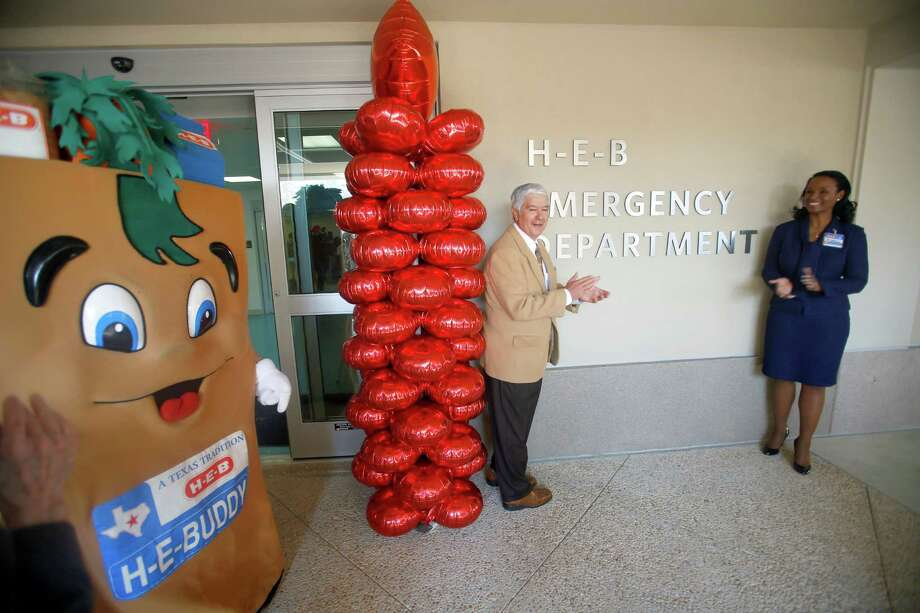 Ray Carvajal, left, the Childrens Hospital of San Antonio Foundation board chairman, and Winell Harron, HEB group vice president of Public Affairs stand Wednesday Feb. 25, 2015 next to the newly unveiled sign marking the Children's Hospital of San Antonio Emergency Room as the HEB Emergency Department after the local grocer donated $5 million to the project. Photo: William Luther, San Antonio Express-News / © 2015 San Antonio Express-News