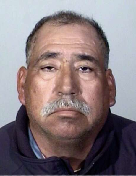 This Tuesday, Feb. 24, 2015 booking photo provided by the Oxnard Police Department shows Jose Alejandro Sanchez-Ramirez, 54, of Yuma, Arizona, who was the driver of a pickup truck that a Southern California commuter train smashed into on Tuesday, Feb. 24, 2015. He was found about a half-mile away from the crash 45 minutes later, said Jason Benites, an assistant chief of the Oxnard Police Department.  Sanchez-Ramirez was briefly hospitalized before being arrested Tuesday afternoon on suspicion of felony hit-and-run. (AP Photo/Oxnard Police Department) Photo: Associated Press / Oxnard Police Department