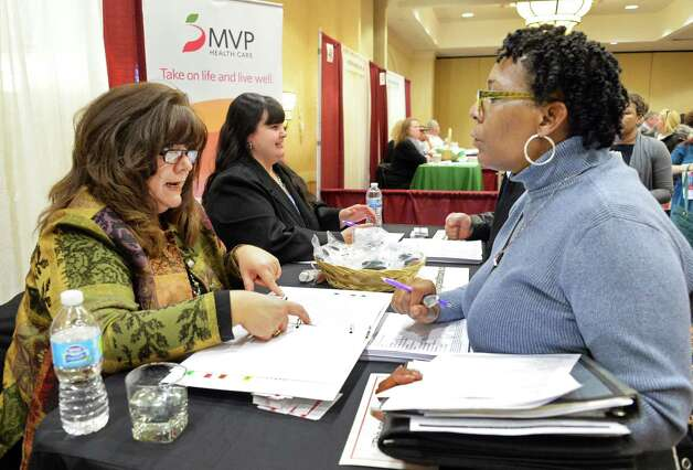 MVP recruiter Carolyn Vinci, left, speaks with Carla McClain of Schenectady during the Times Union's job fair focusing on health careers at the Albany Marriott hotel Wednesday Feb. 25, 2015, in Colonie, NY.  (John Carl D'Annibale / Times Union) Photo: John Carl D'Annibale / 00030753A