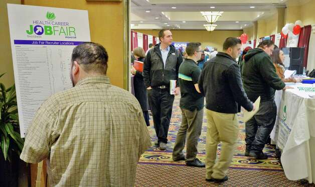 Job hunters file into the Times Union's job fair focusing on health careers at the Albany Marriott hotel Wednesday Feb. 25, 2015, in Colonie, NY.  (John Carl D'Annibale / Times Union) Photo: John Carl D'Annibale / 00030753A