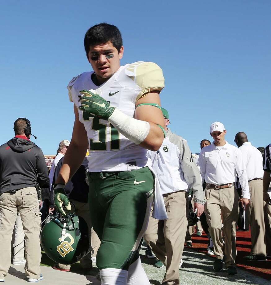 In this Nov. 8, 2014, photo, Baylor player Silas Nacita walks off the field after a game against Oklahoma in Norman, Okla. Photo: Rod Aydelotte /Waco Tribune-Herald / Waco Tribune Herald