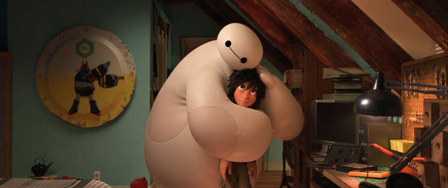 "Hiro Hamada, voiced by Ryan Potter, and Baymax, voiced by Scott Adsit, in a scene from ""Big Hero 6."" Photo: Uncredited / Associated Press / Disney"