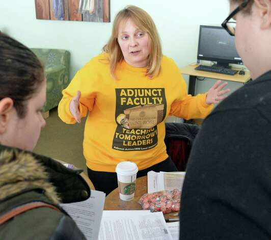College of Saint Rose adjunct Alyssa Colton, center, speaks with to students during an adjuncts protest at the college Wednesday Feb. 25, 2015 in Albany, NY.  (John Carl D'Annibale / Times Union) Photo: John Carl D'Annibale / 00030709A