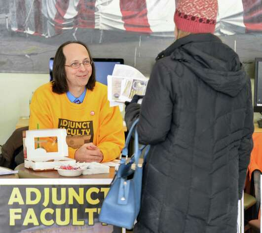 College of Saint Rose adjunct David Ciucevich, left, speaks with a student during an adjuncts protest at the college Wednesday Feb. 25, 2015 in Albany, NY.  (John Carl D'Annibale / Times Union) Photo: John Carl D'Annibale / 00030709A