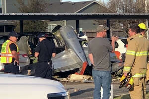 First responders work the scene of a plane crash Saturday afternoon in Fredericksburg, Texas.  The P-51 Mustang crashed into the Terrace at Creek Street Apartments and early reports indicate two people were killed in the crash, both veterans.