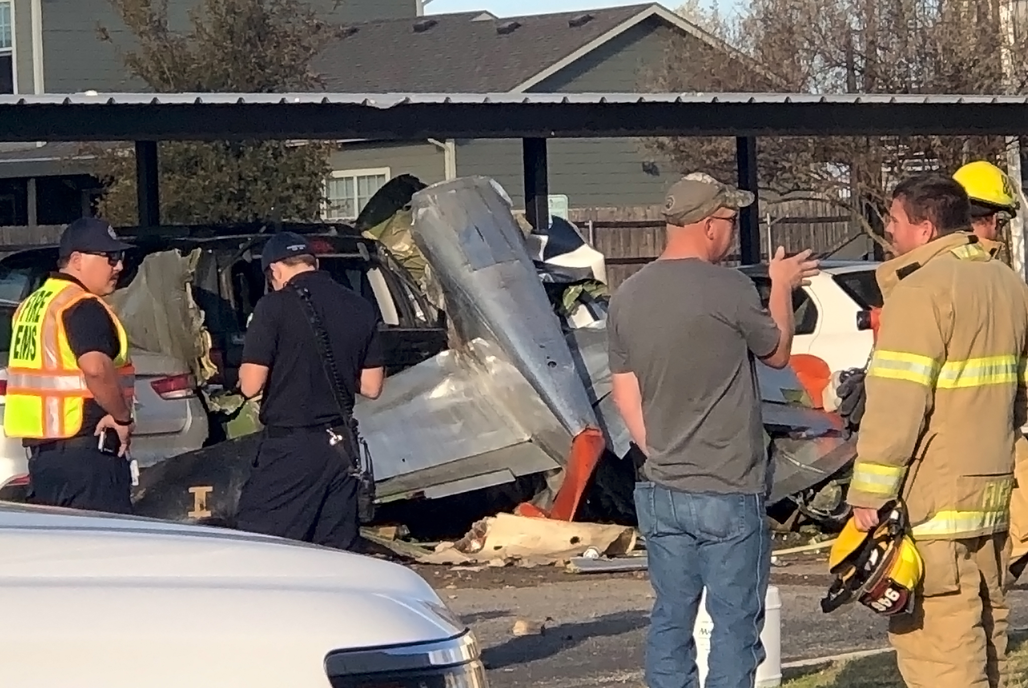 Vintage World War II plane crashes into an apartment parking lot killing 2 in Fredericksburg