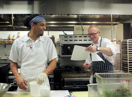 Sprig's Kitchen Manager Anthony Moore, left, shares a laugh.
